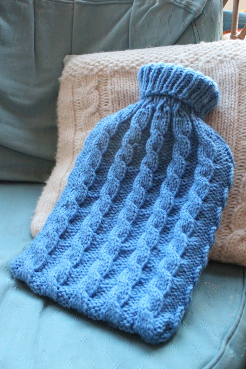 Knitted hot water bottle cosy