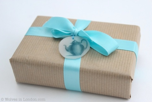 Wrapped present with teapot gift tag