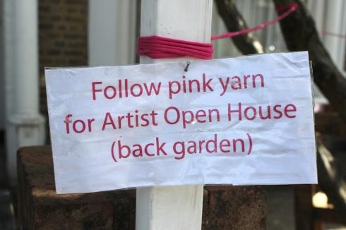 Follow pink yarn sign