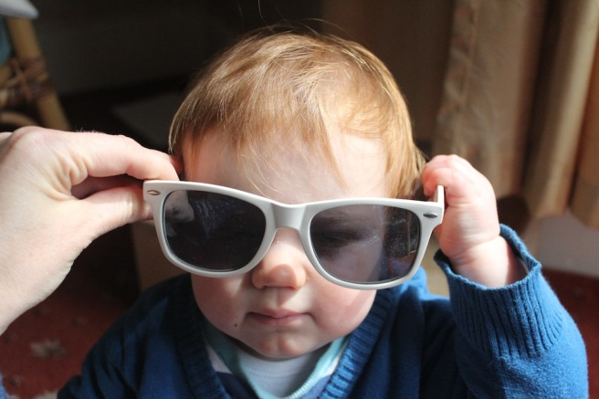 Wearing Daddy's sunglasses