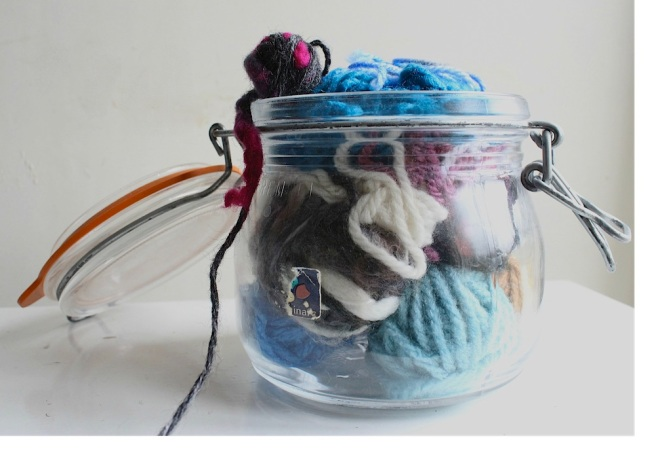 Wool in a glass jar