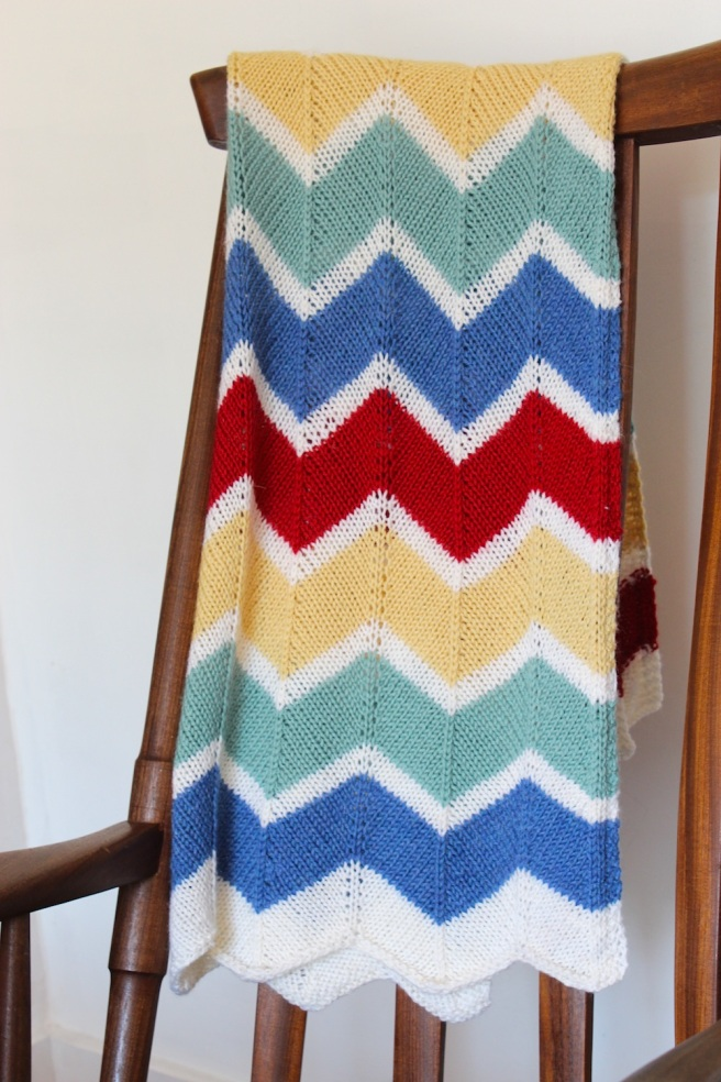 Handknit chevron rainbow blanket | Wolves in London