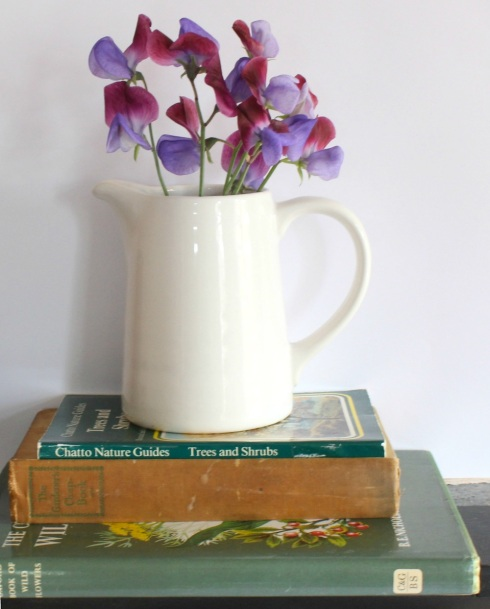 Book stack and sweet peas