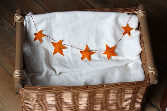 Homemade orange peel star garland in a Christmas hamper