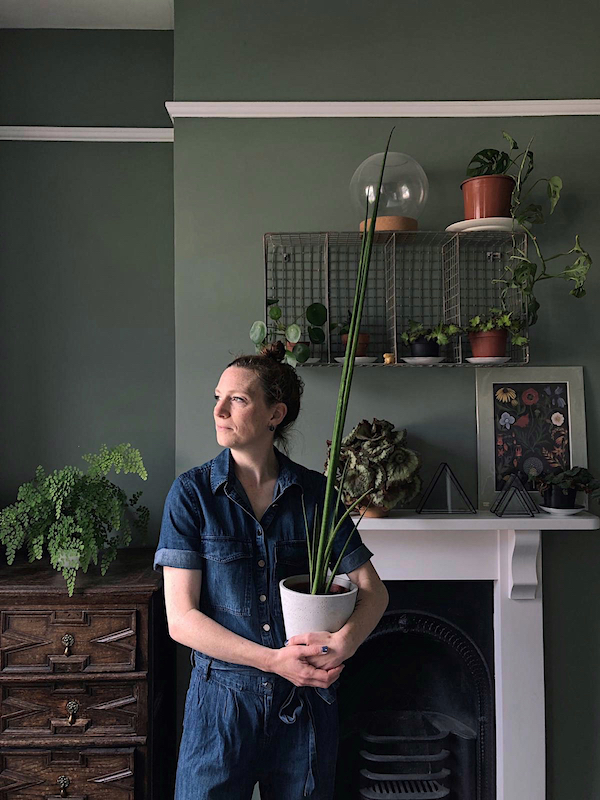 woman holding a houseplant